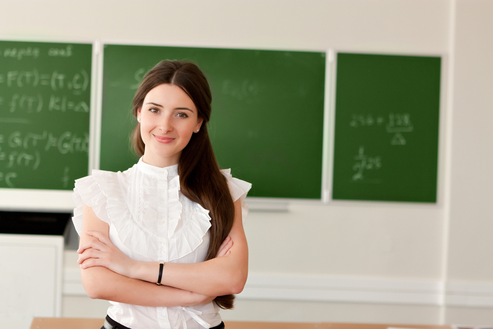teacher on blackboard background